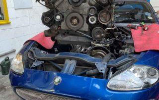 Jaguar XK8 Engine knocking photo of XK Engine being replaced